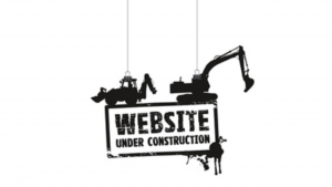 A picture of 2 tractors and the words website under construction