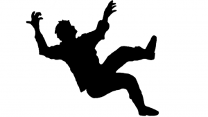 a black and white picture of a man slipping and falling