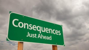 A picture of a green road sign that reads consequences just ahead
