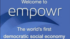 A blue and white screen shot that reads, Welcome to Empowr, the worlds first democratic social economy
